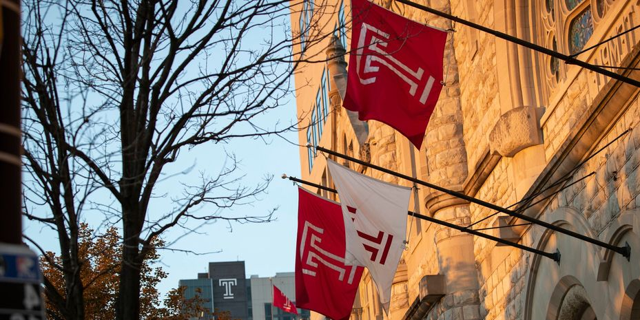 Temple flags flying as the sunsets.