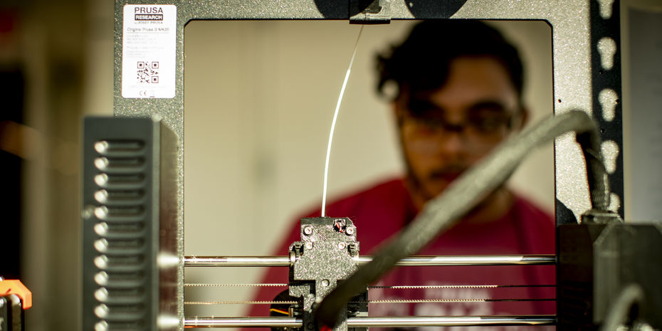 An engineering student works in a lab on campus.