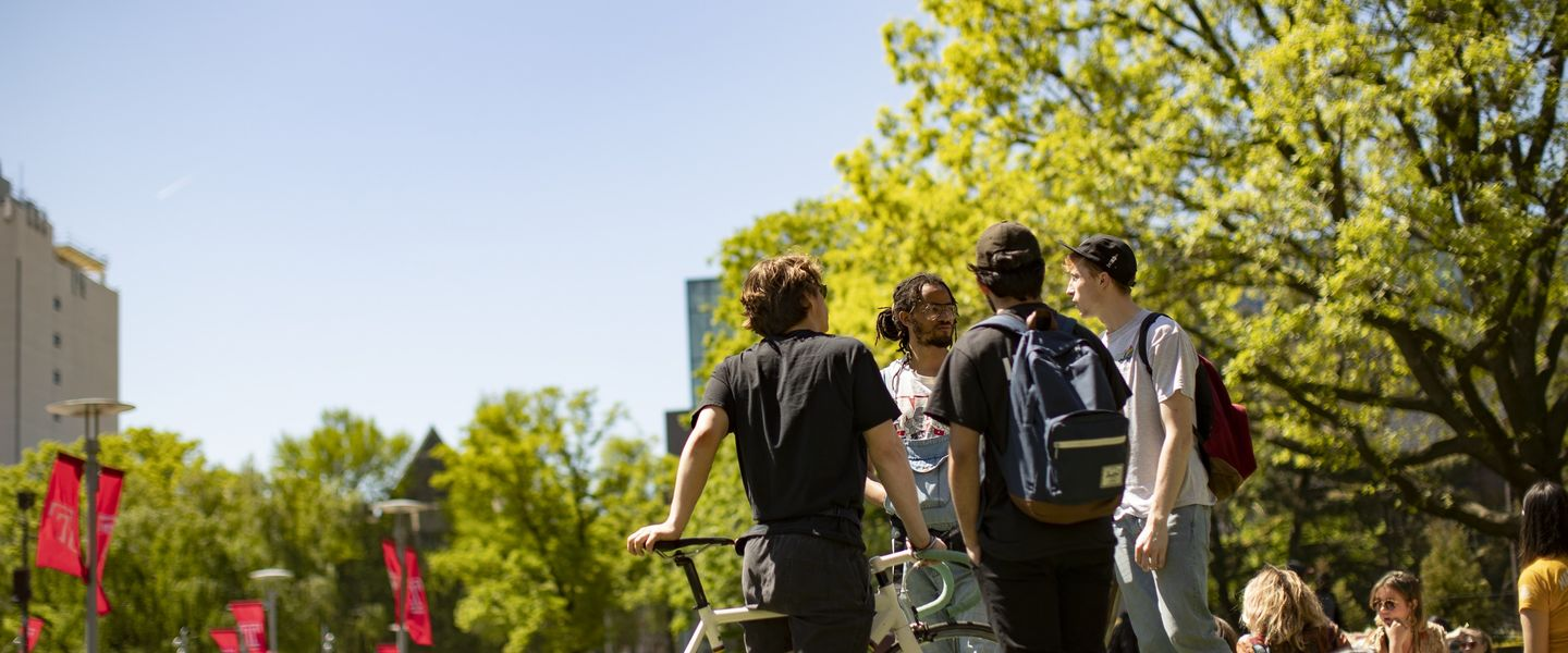 Students gather on Main Campus on a sunny spring day.