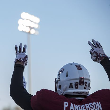Temple football player taking the field.
