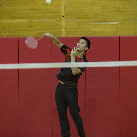 student playing badminton.