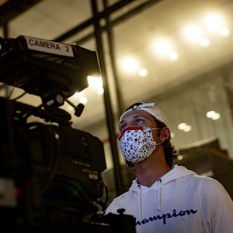 A student works a tv camera.