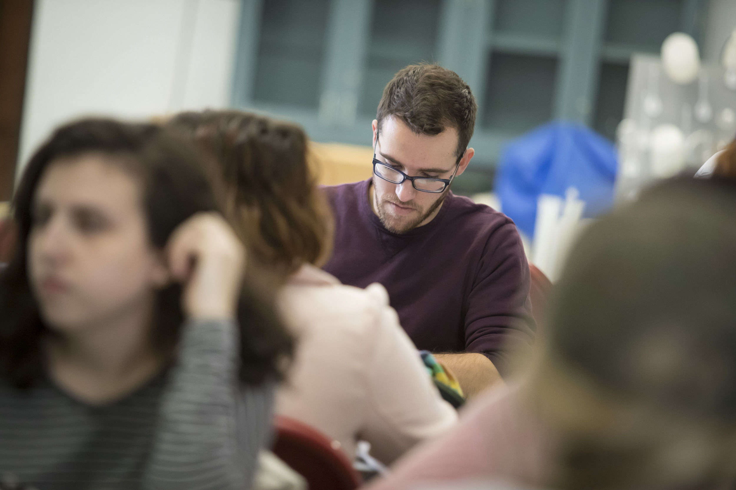 A group of Temple students are studying together.
