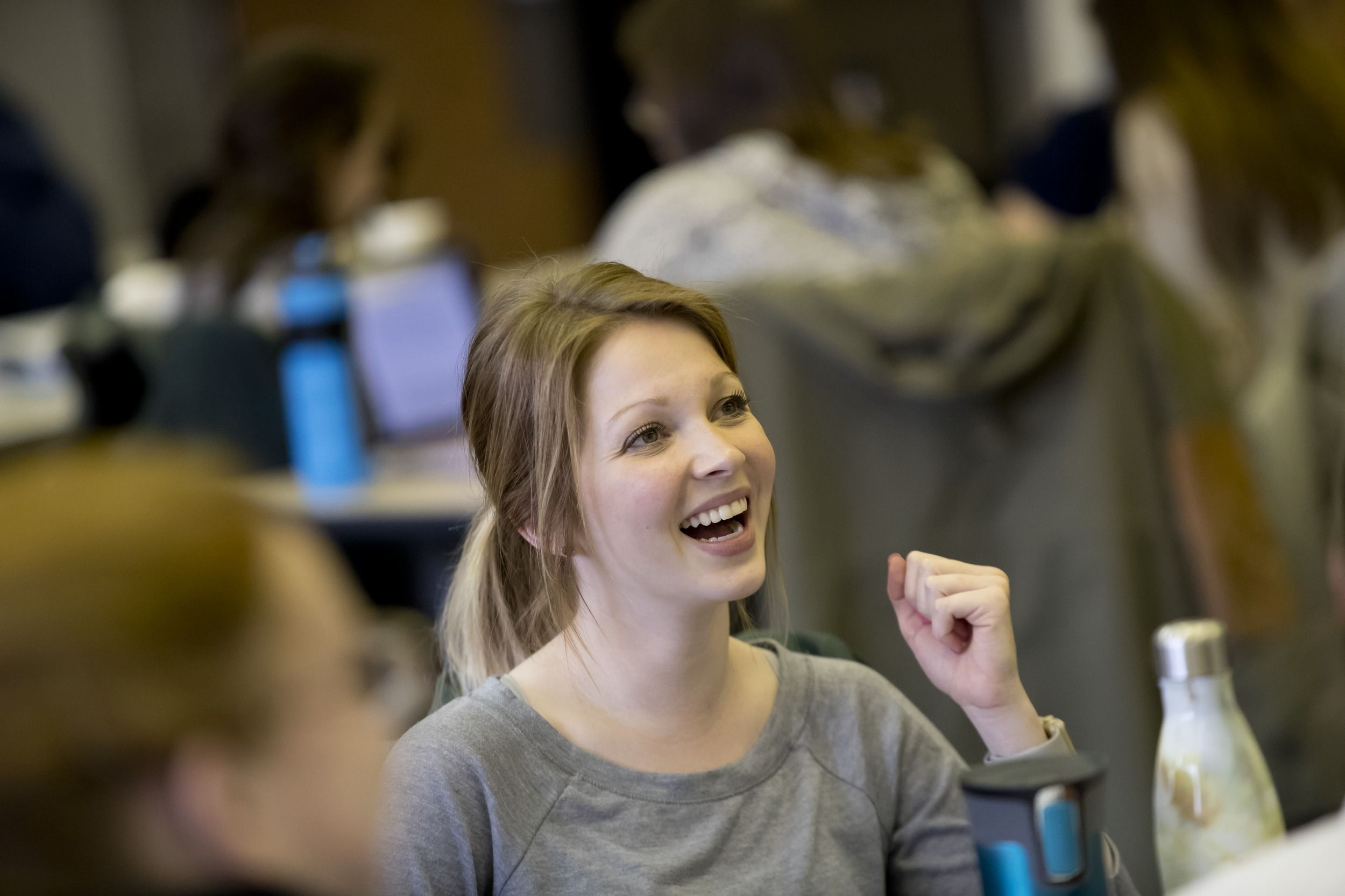 College of Public Health students talk during class.
