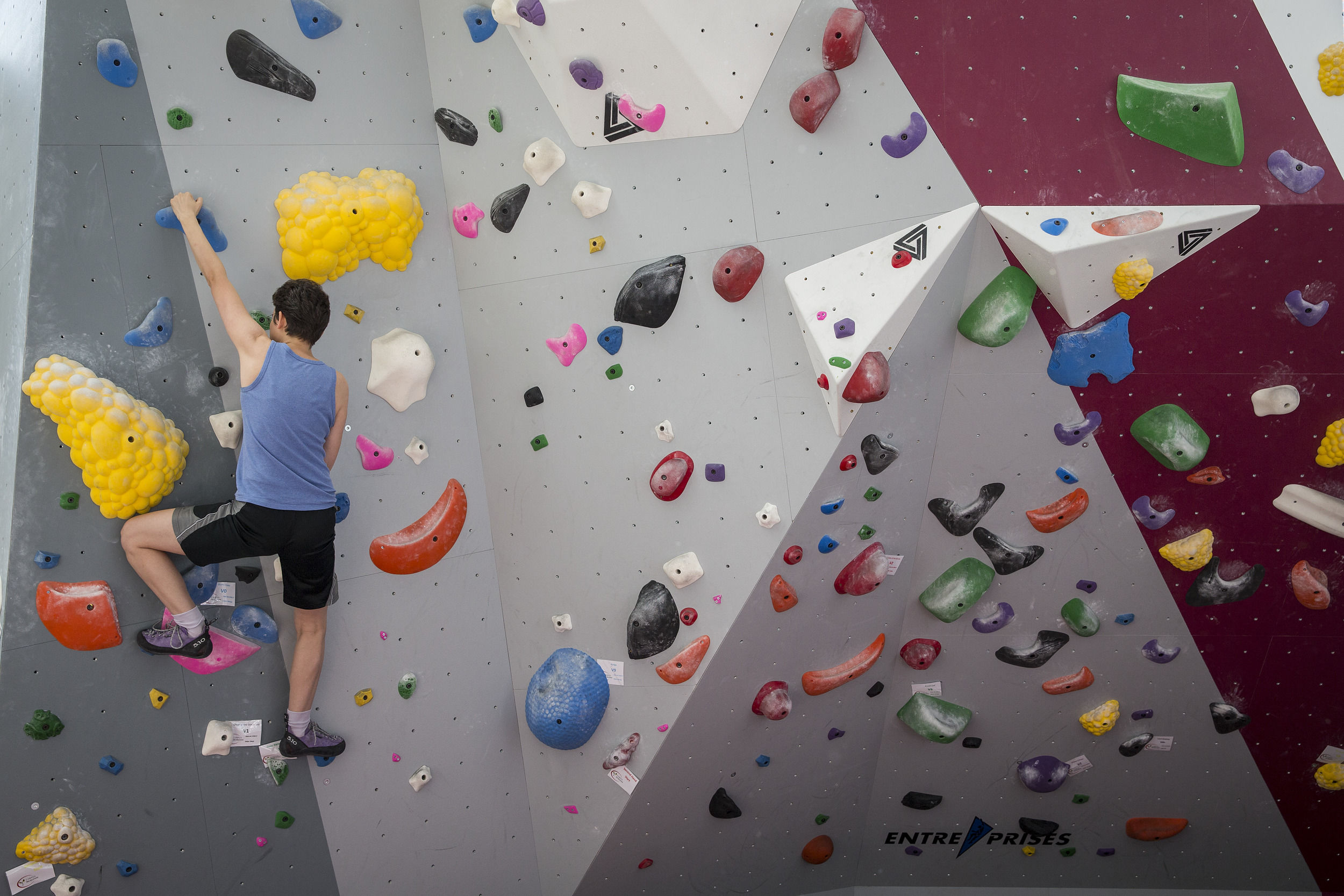 student conquering the rock climbing wall in the STAR Complex.