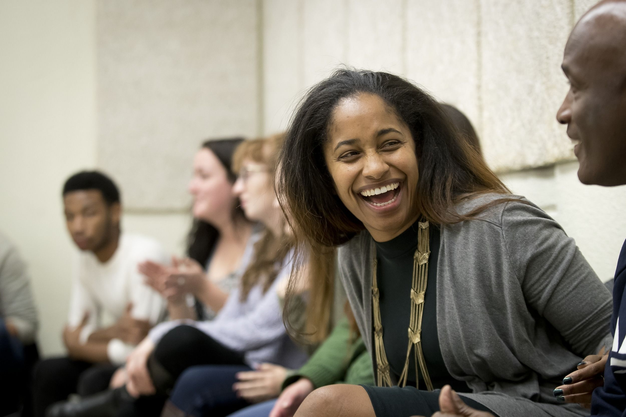 Students talk during a class at Temple.