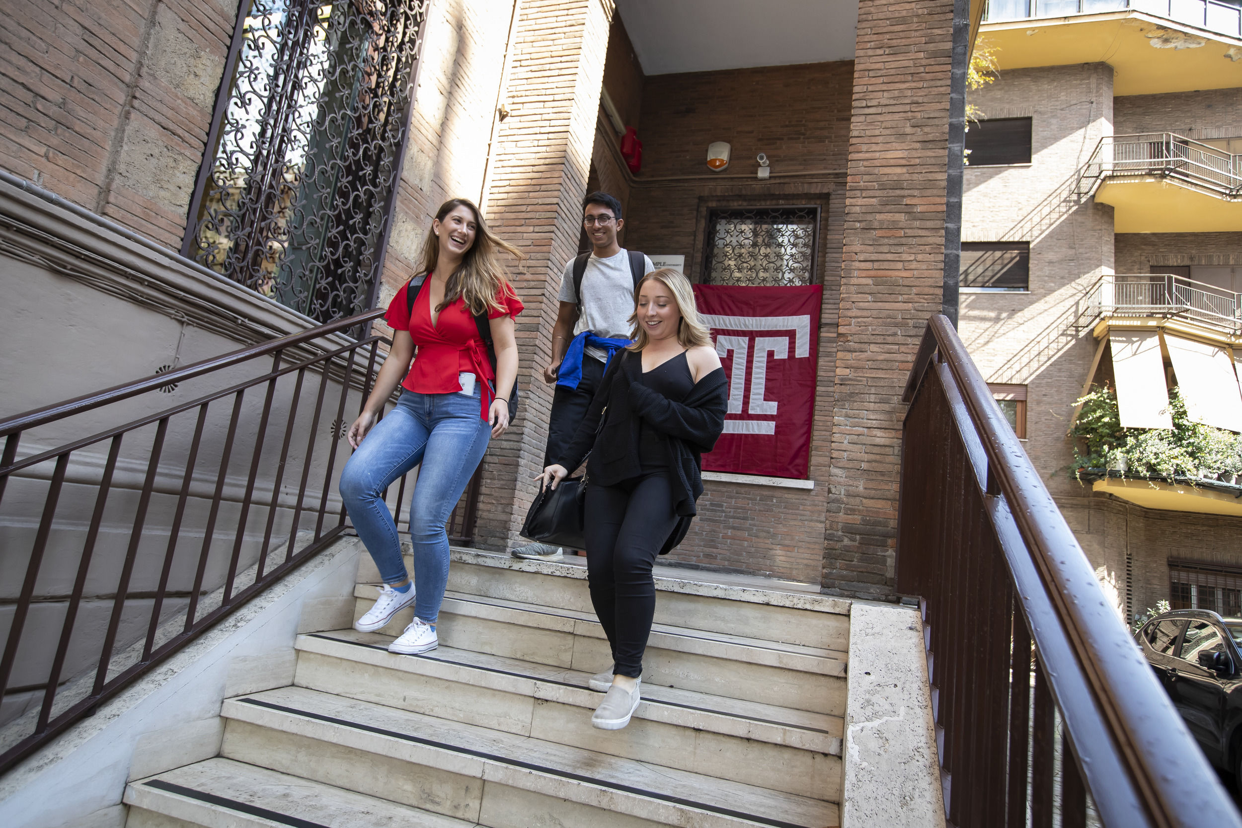 Students leaving a building on Temple Rome campus.