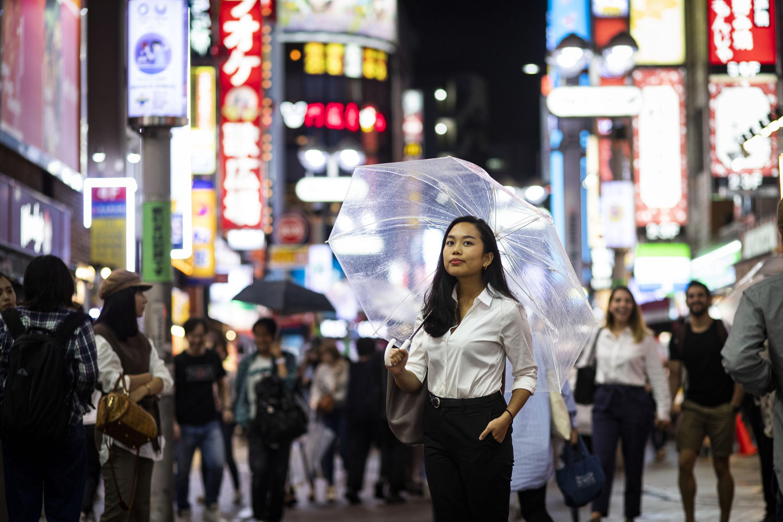 A shot of a student walking through Tokyo.