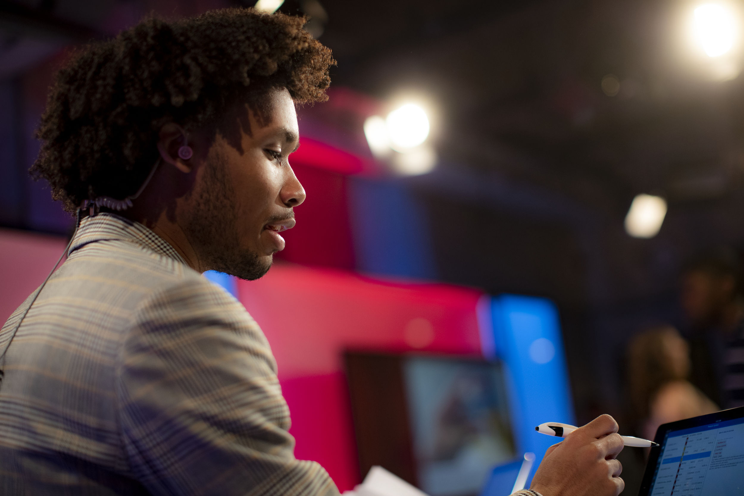 A Klein College of Media and Communications student works in the studio during a class.