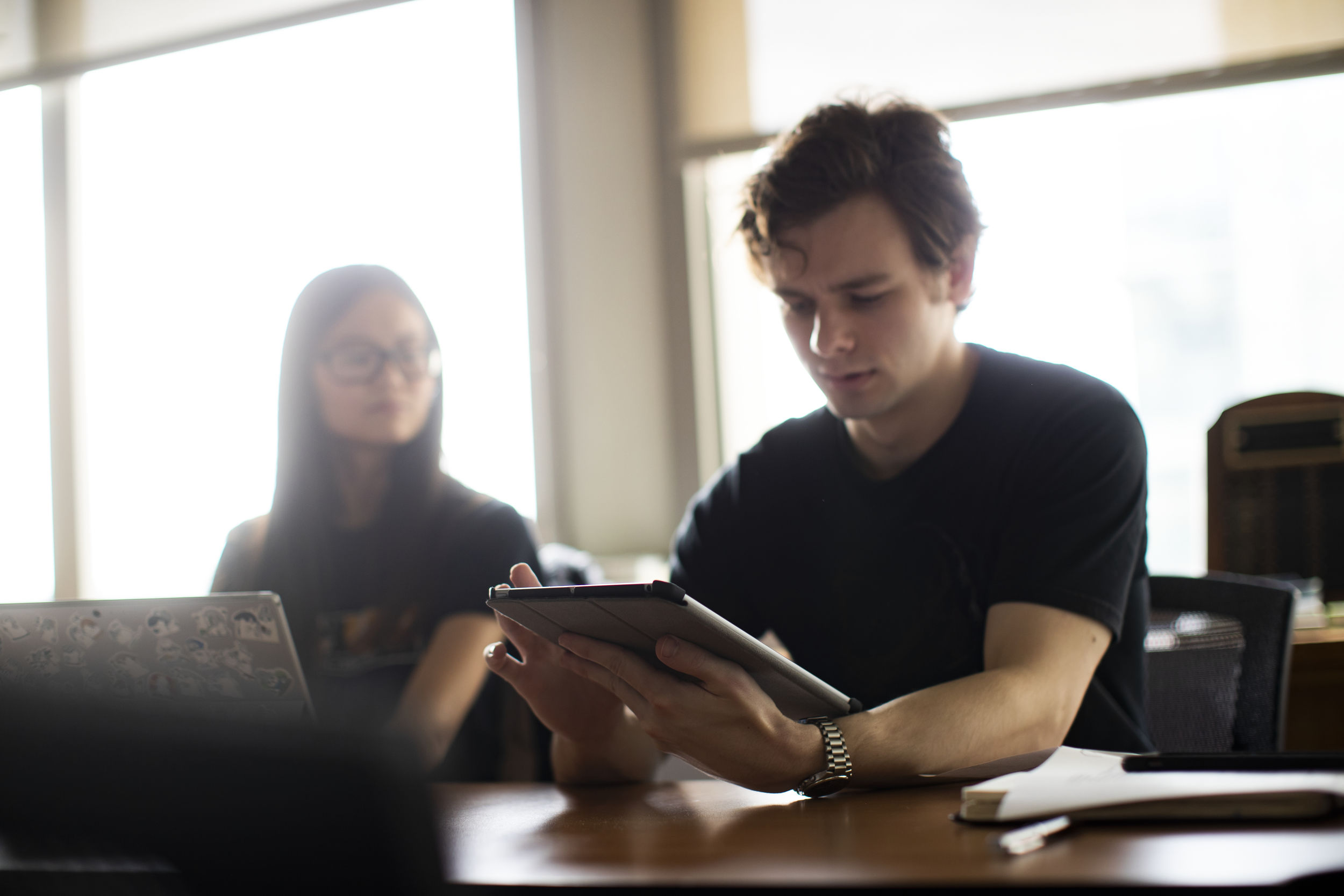 Students collaborate during a meeting of Diamond Edge Communications, Temple's student-run advertising agency.