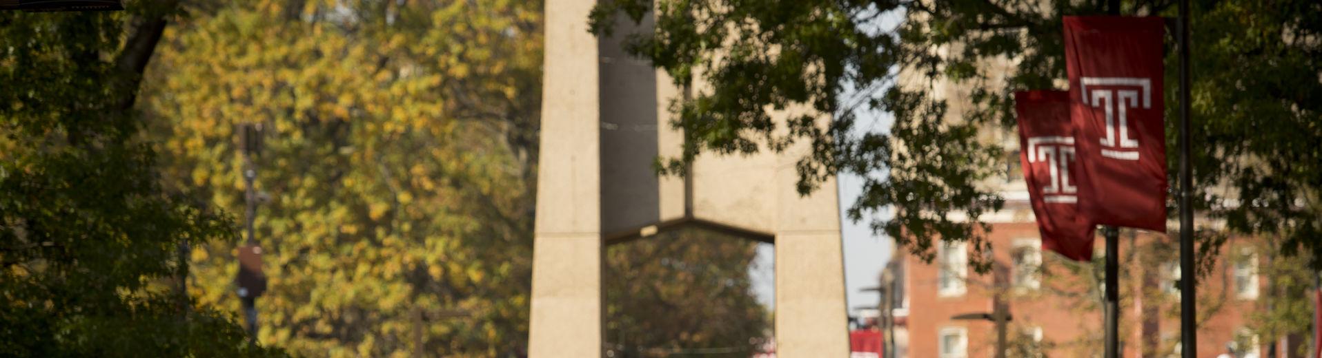 Students walking during class change under bell tower