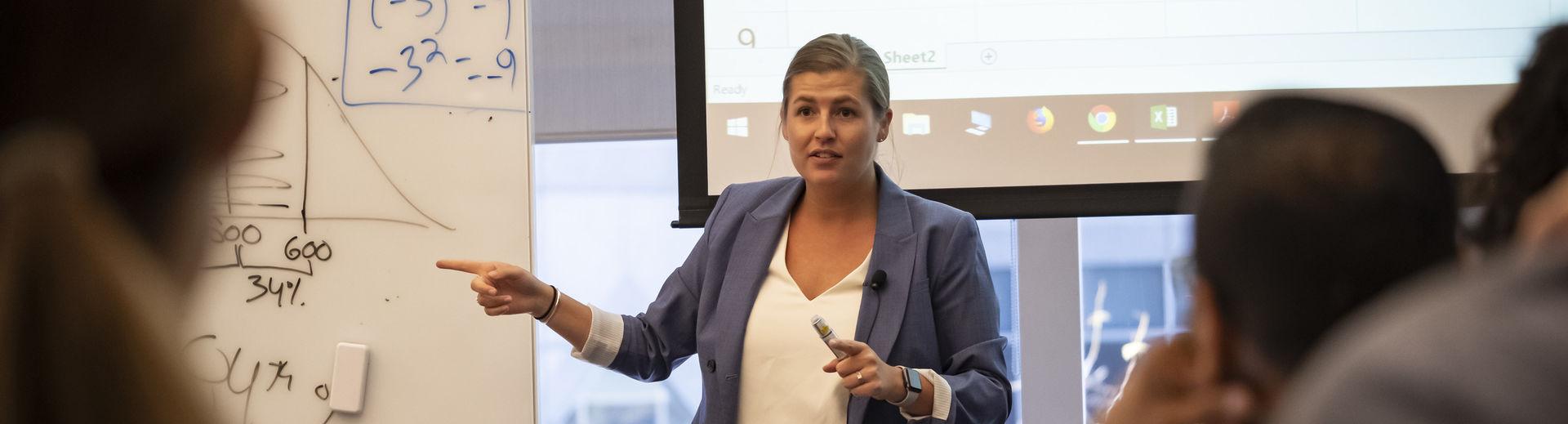 Fox professor instructing her students.