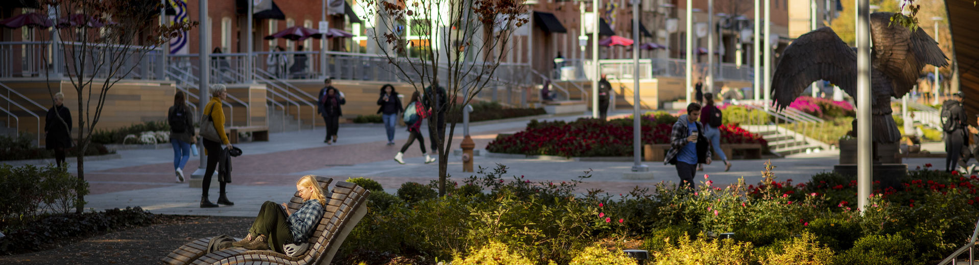 Students walking through O'Connor Plaza on a sunny fall day.