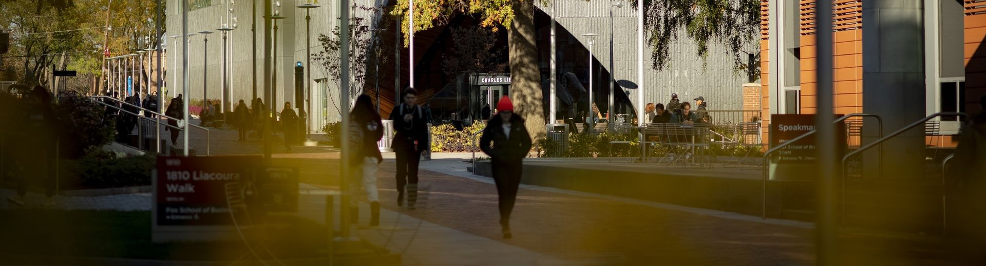 Students walking across Liacouras Walk on Main Campus on a fall day