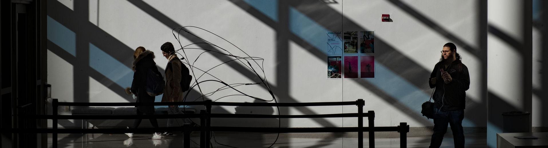 an art student admiring an abstract sculpture.