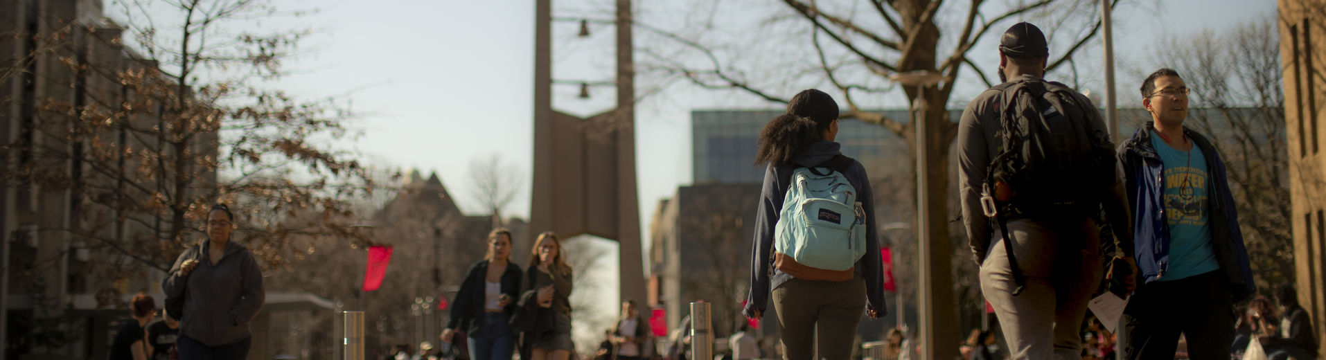 students walking across campus on a fall evening.