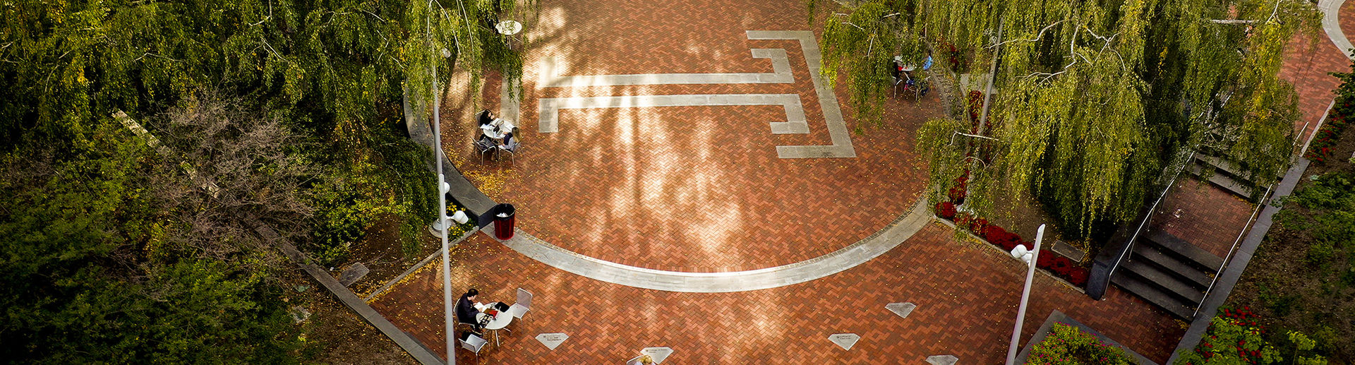 Overhead image of students sitting in O'Connor Plaza on a sunny fall day