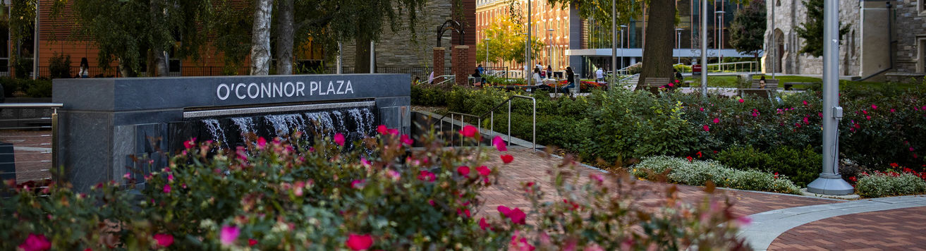 Colorful flowers and trees in O'Connor Plaza on Temple's Main Campus