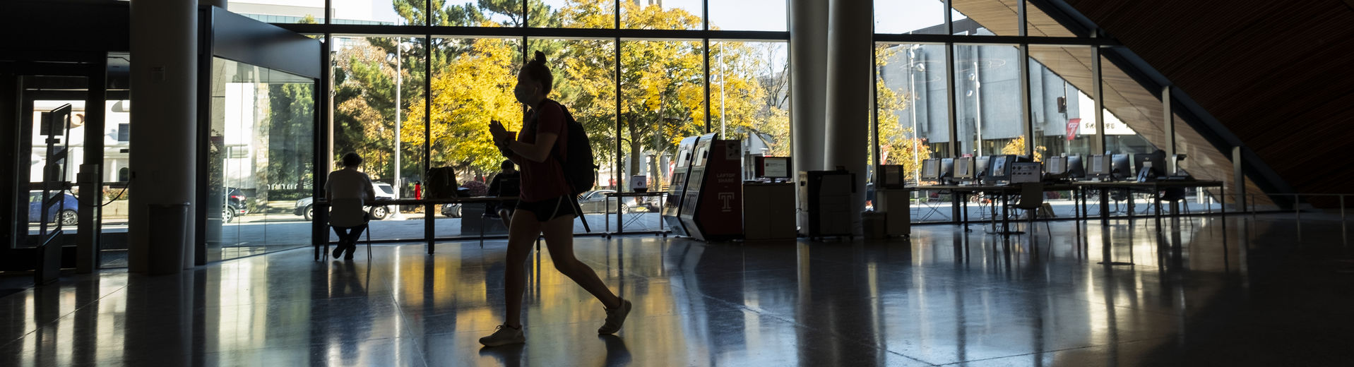 Students walking through the Charles Library lobby on Main Campus