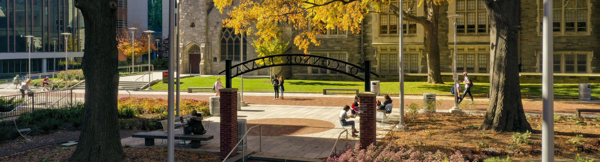 Students in O'Connor Plaza on a sunny fall day